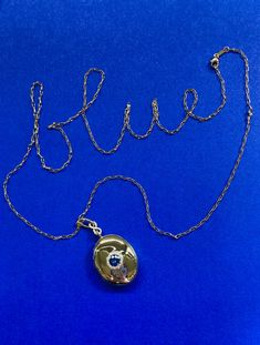Blue sapphire locket set in 18k yellow gold and diamond accents. #sapphirejewelry #sapphirelocket #goldlocket