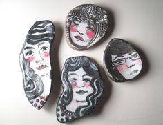 Ceramic faces by Julie Bergeron