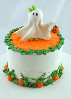 Pumpkin Patch Cake: A tutorial for making this adorable pumpkin patch cake with ghost topper. #halloween #cakes