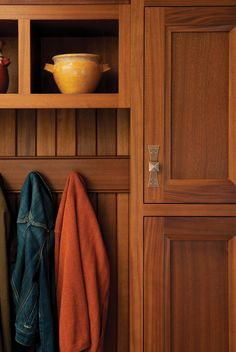 The beauty of Sapele is highlighted in this close-up shot of a custom mudroom cabinet.  The rich warmth of the wood is brought out by a Honey stain.