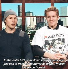 """Erik Johnson and Gabriel Landeskog, who is wearing his """"I ♥ AMERICAN BOYS"""" shirt for losing a bet. (GIF. Click to watch them laugh silently.)"""