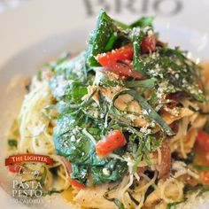 Angel hair tossed with grilled chicken, caramelized onions, basil, tomatoes, roasted peppers, Feta and spinach