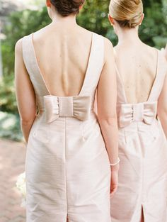Classic & pretty bow back dresses: http://www.stylemepretty.com/north-carolina-weddings/pittsboro/2015/09/04/summer-garden-wedding-at-fearrington-house/ | Photography: Marcie Meredith - http://marciemeredith.com/