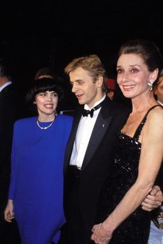 The French singer Mireille Mathieu photographed with Mikhail Barychnikov and Audrey Hepburn at a Gala at the Moulin Rouge; in Paris (France), on December 01, 1986. -Audrey was wearing creations of Givenchy.