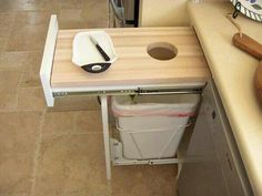 Pull out cutting board over trash can.