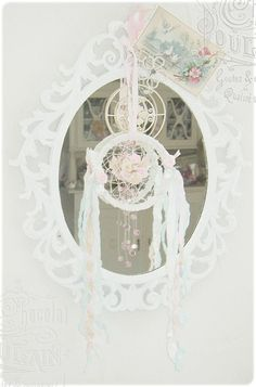 shabby mirror with dream catcher