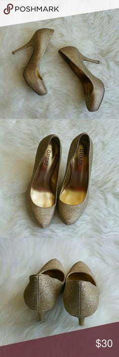 "Gold glitter Guess heels Gently used gold glittered shoes. No significant gold flaking, shoes are still fully covered. No scrapes, scuffs, or scratches. Exact shoe measurement: 7.5"" X 3"". 3"" heel with 1"" hidden platform. Guess Shoes Heels"