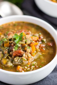 A close up shot of a bowl of slow cooker vegetable soup made with soup mix.