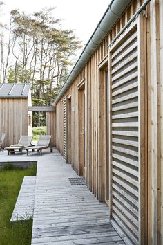 Architect-designed wooden holiday house in Denmark. Modern Wooden House, Modern Barn House, House Gutters, Small Summer House, Small Dream Homes, Summer House Interiors, Timber Buildings, Stone Houses, Farmhouse Design