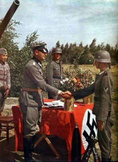 German Army officer shake hands with his soldier in the latter's proxy marriage wedding ceremony. Picture allegedly taken in the outskirts of Stalingrad, summer 1942 German Soldiers Ww2, German Army, Military News, Military History, Battle Of Stalingrad, Ww2 Photos, Images Photos, Bing Images, Evil Empire