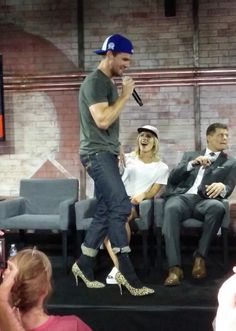 Stephen walking in heels and Em looking at home proudly lol
