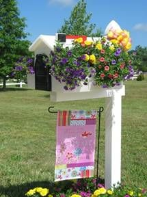 Slip over Mailbox Planter ~  This would never last here~ we have mail box baseball bashers. If you have a baseball bat,a fast car,  a friend with a strong arm ~ you're ready to play mail box baseball.We're on our 4th mailbox from this dumb game the kids play in the dark of the night!GRRRRRRRR