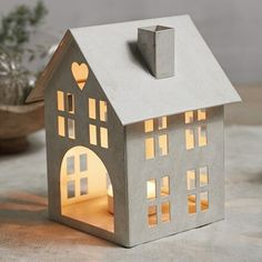 Our charming little house-shaped candle holders are a beautiful addition to your Christmas decorations. Rustically painted white and finished with a cut-out door on the back, you can pop a tealight inside and watch the light glow through the windows. Christmas Room, Christmas Crafts, Christmas Decorations, Christmas Ornaments, Room Decorations, House Candle Holder, Candle Holders, Putz Houses, Home Candles