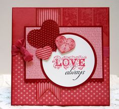 monochromatic handmade Valentine ... square card with layers of gorgeous red print papers ... die cut hearts ... Stampin' Up!