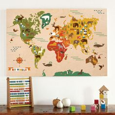 Map of the world wall art featuring animals from each country or continent.  What a great way to introduce your child to his or her au pair's home.