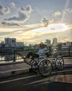 A cyclo driver rests in his vehicle as the evening sun sets behind him. Seeing him ahead of me on the bridge I was crossing in a cab I just barely had enough time to fumble up my phone and capture this moment and yet I think it's one of my favorites from this week.  #saigon #vietnam #cyclo #somewhereinsaigon #traveltuesday #tanyaolanderphoto #travelsnaps #instapassport #vietnamese #saigonese #hochiminhcity #sunset #dusk #galaxys7 #hochiminhcity