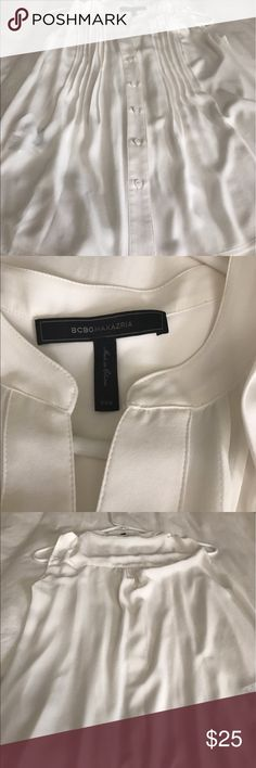 BCBG Max Azaria Silk Chiffon Blouse Beautiful BCBG White Sleeveless Silk Chiffon Blouse.  Gently used. Please review the photos carefully as item is gently used and dry cleaned.  Please ask any questions or concerns prior to purchase.  Thank you 🙏💛 BCBGMaxAzria Tops Blouses