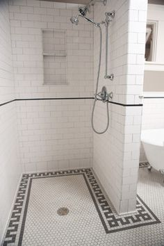 Black and white bathroom with subway tile walls and hex tile floor with geometric border - tile by Clay Squared to Infinity, claysquared.com - Sarah Whiting Photography