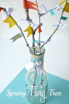 Gather some twigs from the yard and add some flags to make this easy spring tree for a piece of home decor.