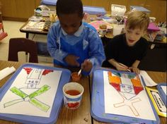 Dutch Windmills - tracing objects with oil pastels to draw the windmills, painted with cake tempera, first graders