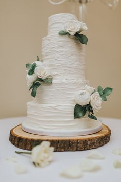 Rustic Buttercream Wedding Cake with White Sugar Flowers Photo by Emily Crutcher Photography
