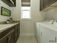 Traditional Laundry Room with GE 3.8-cu ft Top-Load Washer, Built-in bookshelf, travertine tile floors, High ceiling