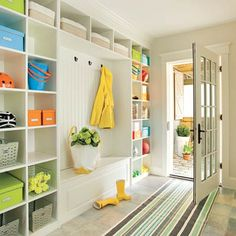 bright, cheerful, well-organized mudroom with plenty of storage spots.  thisoldhouse.com; Photo: Eric Roth