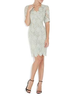 Lace | Mint + Gold.  Lace Dress | #fashion #wedding | Moss & Spy 2014 Collection. This stunning dress is made of metallic lace in a mint colour with gold throughout. The fitted dress falls to the knees and features sleeves and a V neckline.