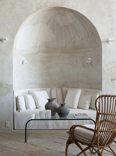 Shapiro designed sweet places for repose—including an outdoor terrace and a plastered hemispherical niche with a custom-designed curved sofa.