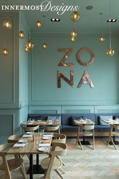 What a fun restaurant! They make the most of their high ceilings by placing the focal points (hanging lights and the restaurant sign) towards the top of the wall, drawing your eye upwards.