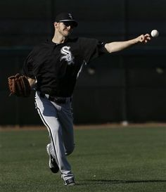 Chicago White Sox pitcher Chris Sale throws during spring training baseball in Phoenix, Thursday, Feb. 21, 2013. (AP Photo/Paul Sancya)