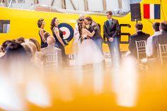Bethany & Shawn's geeky retro aviation museum wedding | Offbeat Bride