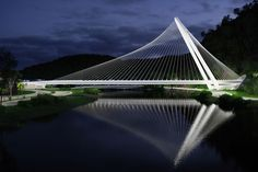 santiago calatrava rio barra bridge rio de janeiro brazil designboom. supporting the bridge's deck, a gleaming white steel arch rises to a height of 70 meters