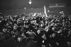 A pitch invasion at Old Trafford as Manchester United clinch the First Division Championship in 1965 against Arsenal.