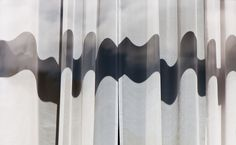 It's Curtains - Shadows on a window curtain form an abstract ribbon...