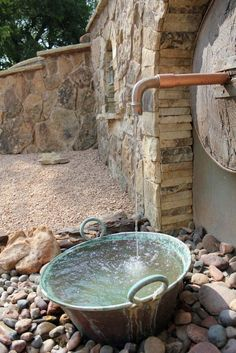 A very unique custom landscape design that uses an antique faucet as a main water feature. Beside this water feature are two lanterns and with laid flagstone Outdoor Water Features, Water Features In The Garden, Garden Features, Landscape Design, Garden Design, Backyard Water Feature, Garden Fountains, Outdoor Living Areas, Water Garden
