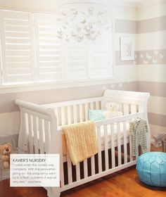 Plantation shutters and stripped painted walls. baby room