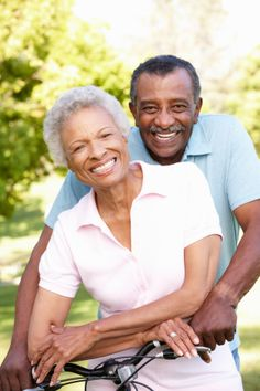 Photo about Senior African American Couple Cycling In Park. Image of enjoyment, park, people - 55893878