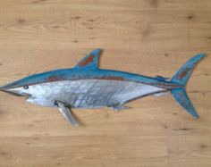 Walleye sculpture is great for your Lake,Lodge. or cabin look.  - Shipping in the US is $20.00  - All of my sculptures are made of 18ga steel. Each sculpture is cut by hand with a Plasma cutter. Next fish is shaped with a Brass hammer and a wood block. Then sculpture is welded together (no jigs are used).  - Walleye has a custom Copper / Green Patina. 2 coats of interior/exterior clear protect the custom Patina.  - Build time is 7 to 10 working days  - mounts are welded to the back of the…