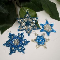 I really like the darker blue snowflake. You can find the pattern here: http://store.sandradhalpenny.com/snowflake-41-ornament-pattern-p463.php