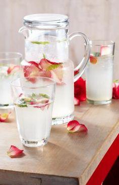 Lemon juice, sugar, Rosewater, soda water, and Mint spa water -- must try this! Refreshing Drinks, Summer Drinks, Fun Drinks, Healthy Drinks, Cocktails, Non Alcoholic Drinks, Cocktail Drinks, Limonade Rose, Flower Food