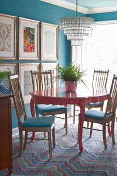 Teal and coral in a dining room with cool framed fabric. Not crazy about the table color though.