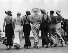 Fashionable lalies in wide-legged pants at beach, ca. 1930s