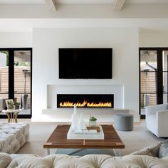 How about this black and white modern family room design? Coastal Virginia Magazine's Best Kitchen & Bathroom Remodeler - How about this black and white modern family room design? Coastal Virginia Magazine's Best Kitchen & Bathroom Remodeler - Living Room Decor Fireplace, Fireplace Tv Wall, Living Room Tv, Fireplace Design, Fireplace Ideas, Fireplace Modern, Linear Fireplace, Contemporary Fireplaces, Basement Fireplace