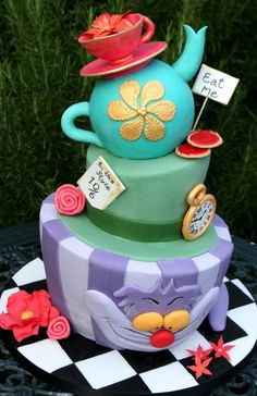 AliceInWonderland Topsy Turvy Cake We love the Cheshire cat, teapot, teacup and lovely details! Great #CakeDecorating We love and had to share!