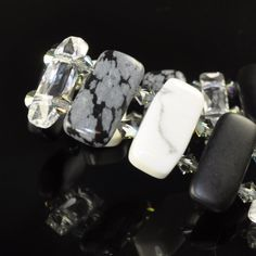 50 Shades of Grey. This bracelet uses double-drilled howlite, snowflake obsidian and matte onyx with Swarovski.