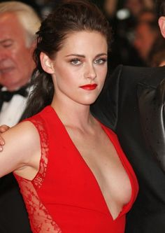 Kristen Stewart in a red dramatic Reem Acra dress with a very plunging neckline at the 2012 premiere of \