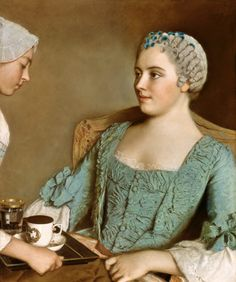Jean-Étienne Liotard - The breakfast. Notice the woman's powdered and tightly curled hair, decorated with small flowers to match her elaborately-designed stomacher and gown. A maid serves her a tray with a cup of hot chocolate.