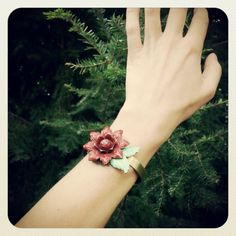 this and that. red flower cuff bracelet made from a vintage metal curtain tie back. by bee vintage redux.