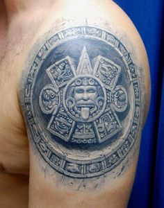 """Tattoo by: Pavel Angel (Moscow, Russia)    His work has a lot of realism and he seem to have developed quite a perfect """"stone effect"""" which he adds to a lot of his designs and which I love. This is an example of that effect, the design is part of the Mayan calendar."""
